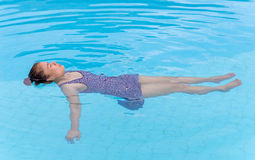 Young woman with swimsuit in swimming pool. Royalty Free Stock Photo