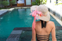 Young woman in swimsuit in swimming pool in gorgeous resort, luxury villa, tropical Bali island, Indonesia. Royalty Free Stock Images