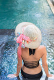 Young woman in swimsuit in swimming pool in gorgeous resort, luxury villa, tropical Bali island, Indonesia. Stock Photos