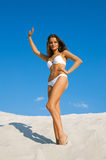 Young woman in swimsuit wave goodbye Royalty Free Stock Photo