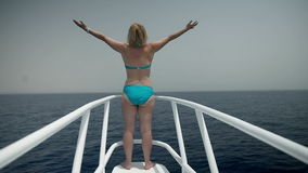 Young woman in swimwear enjoying traveling on sea boat. Tourist resort in Egypt, traveling on the sea, sightseeing animals and sunken ships stock video footage