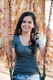 Young woman in a swing Royalty Free Stock Photography