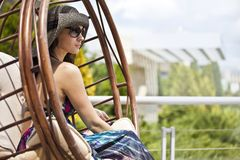 Young woman on a swing. Beautiful Young woman on a swing Stock Images