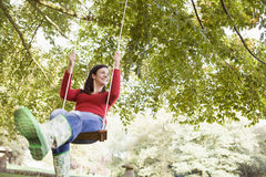 Young woman on swing Stock Photography