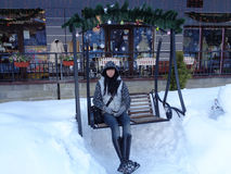 Young woman on swing amid snow. Winter holidays, Christmas Fair, swing amid snow Royalty Free Stock Photos