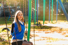 Young woman on a swing Stock Photos