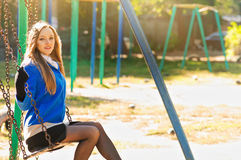 Young woman on a swing Stock Photography