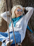 Young woman on a swing Royalty Free Stock Images
