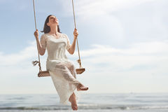 Young woman on a swing Stock Image