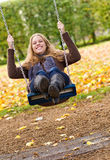 Young woman on swing. Young blond woman on a swing Royalty Free Stock Photography