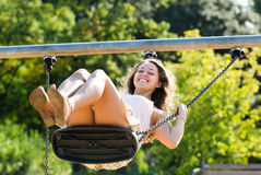 Young woman on swing Royalty Free Stock Photo