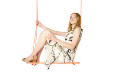 Young woman swinging Stock Photo