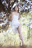 Young woman swinging Royalty Free Stock Photo