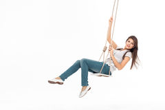Young woman swinging. Alone on a swing royalty free stock photography