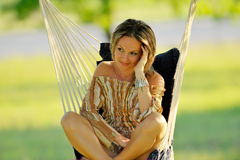 Young woman swinging outdoor Royalty Free Stock Photos