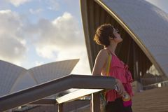 Young woman before Sydney Opera House Stock Images