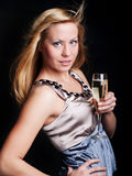 young woman with sylvester champagne over dark Royalty Free Stock Photos