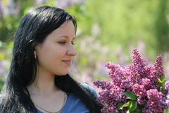 young woman with syringa bouquet Stock Image
