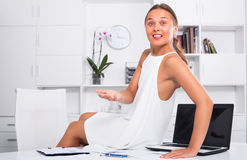 Young woman on the table at office Royalty Free Stock Photography