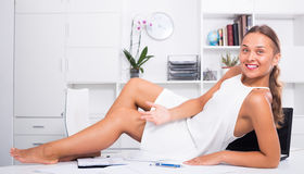 Young woman on the table at office Royalty Free Stock Photo