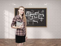 Young woman with tablet and arrow sketch Royalty Free Stock Photography
