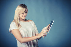 Young woman with tablet on blue Stock Image
