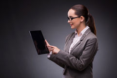 The young woman with tablet in business concept Royalty Free Stock Image