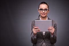 The young woman with tablet in business concept. Young woman with tablet in business concept Stock Image
