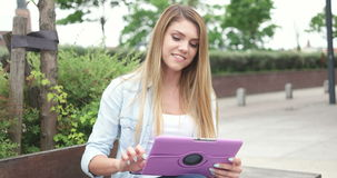 Young Woman with Tablet in the City stock footage