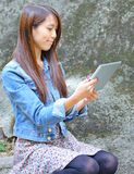 Young Woman With Tablet Computer Royalty Free Stock Images