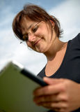 Young woman with tablet computer Royalty Free Stock Photography