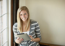 Young woman with tablet computer Stock Images