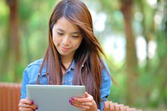 Young woman with tablet computer outdoor Royalty Free Stock Photos
