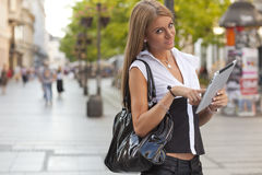 Young Woman with tablet computer on street Royalty Free Stock Photos