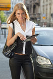 Young Woman with tablet computer on street Stock Image