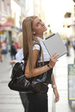 Young Woman with tablet computer on street Royalty Free Stock Photo