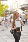 Young Woman with tablet computer on street Stock Photos