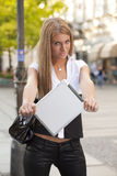 Young Woman with tablet computer on street Royalty Free Stock Photography