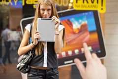 Young Woman with tablet computer walking on street Stock Photography