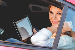 Young woman with tablet in hand Royalty Free Stock Images