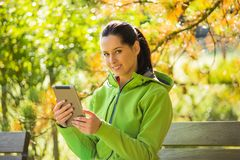Young woman with tablet in hands Royalty Free Stock Photography
