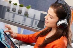 Young woman with tablet and headphones Royalty Free Stock Images