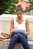Young woman with tablet Royalty Free Stock Photo