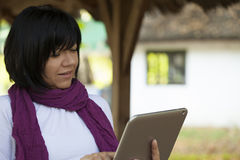 Young woman with a tablet Stock Image