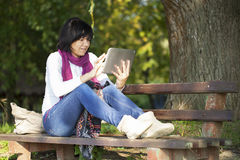 Young woman with a tablet Stock Photos