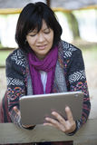 Young woman with a tablet Stock Images