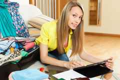 Young woman with tablet before leave Royalty Free Stock Photo