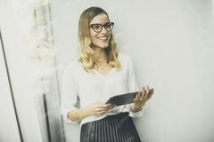 Young woman with tablet in the office Stock Photo