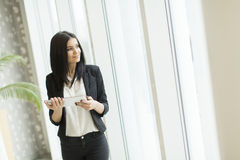 Young woman with tablet in the office Stock Image