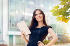 Young Woman with Tablet Out in the City Royalty Free Stock Photos